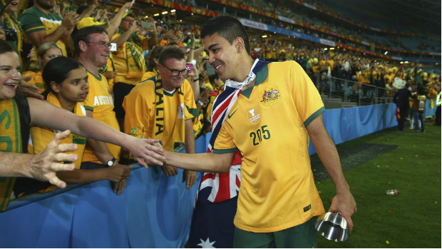 Socceroos midfielder Massimo Luongo thanks members of the crowd after Australia's AFC Asian Cup triumph.