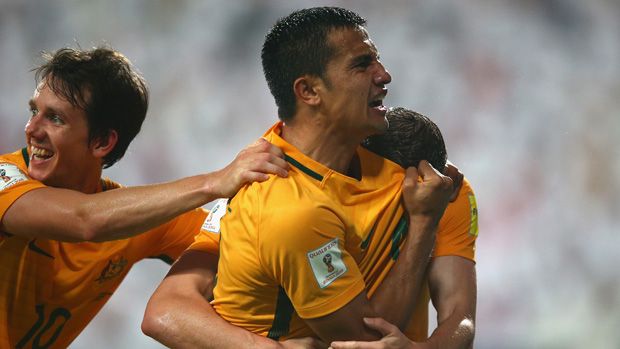 Tim Cahill celebrates with teammates after scoring against the UAE.