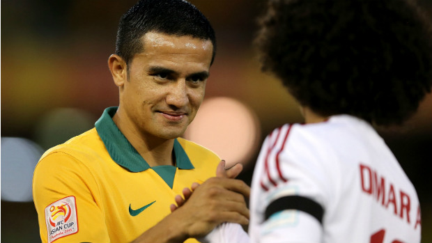 Tim Cahill shakes hands with opponent Omar Abdulrahman during Tuesday's semi-final.