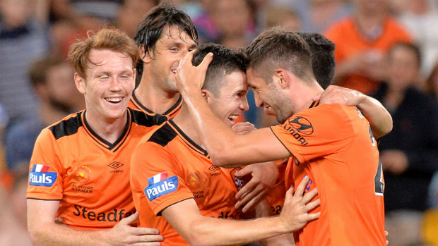 Brisbane Roar players celebrate Brandon Borrello scoring against Adelaide.