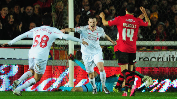 Liverpool left-back Brad Smith celebrates scoring against Exeter City in the FA Cup.