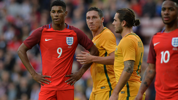 Mark Milligan competes with England young gun Marcus Rashford.