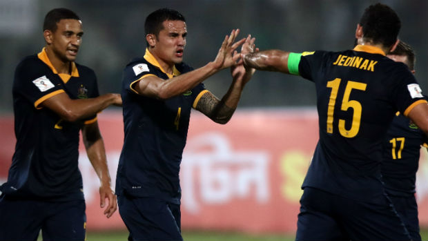 Tim Cahill and Mile Jedinak celebrate the Socceroos' opener against Bangladesh.