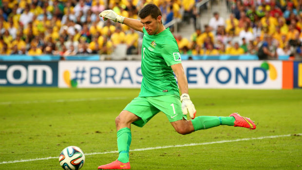 Socceroos goalkeeper Mat Ryan clears the ball against Spain at the World Cup.
