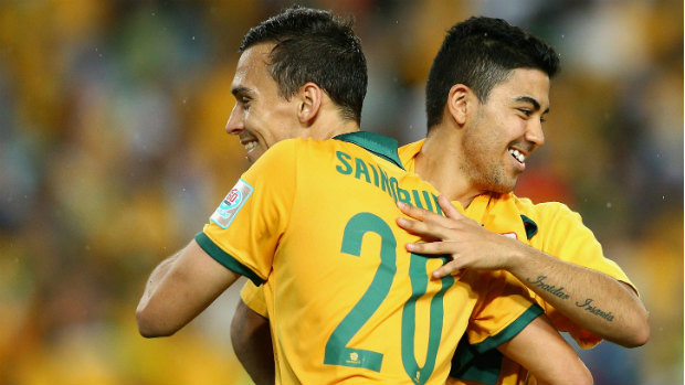 Trent Sainsbury and Massimo Luongo celebrate the Socceroos win over Oman.