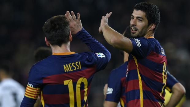 Barcelona's Lionel Messi and Luis Suarez celebrate scoring against Valencia in the first leg of their Copa del Rey semi-final.