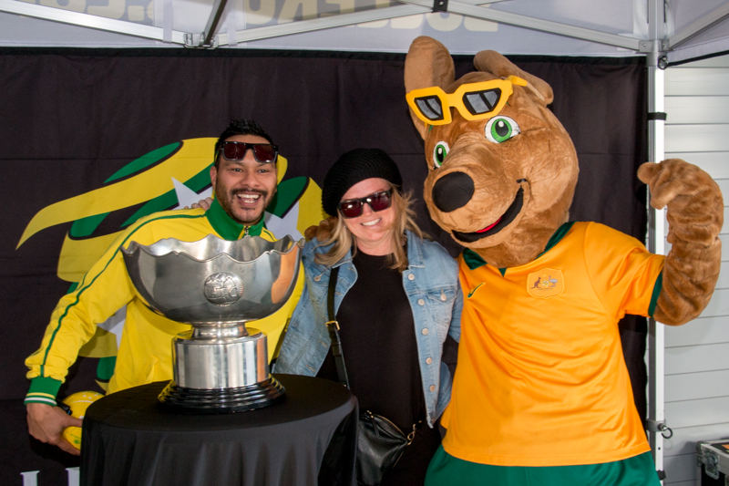 Socceroos mascot Maloo poses with fans and the AFC Asian Cup.