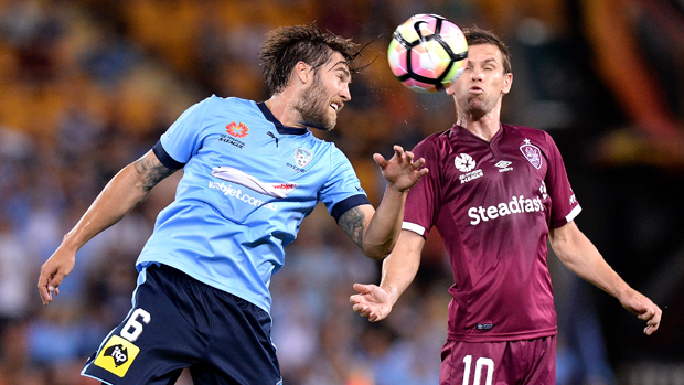 Sydney FC midfielder Josh Brillante challenges for the ball with Roar playmaker Brett Holman.