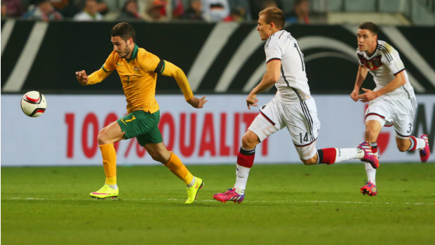 Socceroo Mathew Leckie darts away from Germany's defence.