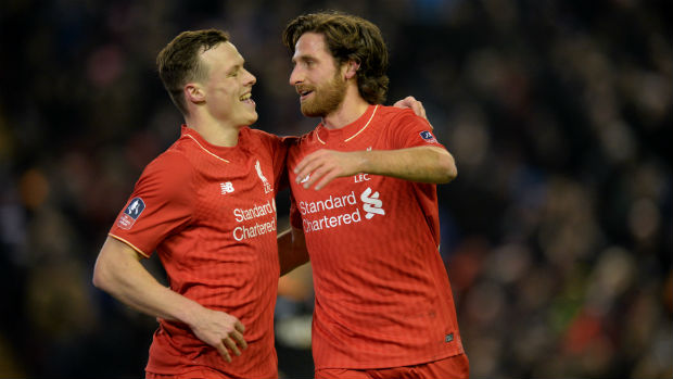 Brad Smith and Joe Allen celebrate combining to score Liverpool's first goal in their FA Cup win over Exeter City.