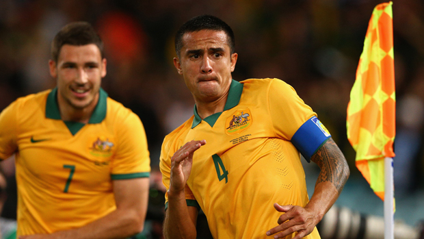 Tim Cahill with his trademark goal celebration for the Socceroos.