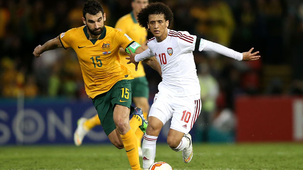 Socceroos skipper Mile Jedinak fights for the ball with UAE superstar Omar Abdulrahman.