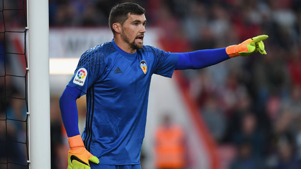 Caltex Socceroo Mat Ryan barks instructions to his Valencia defence during the friendly against AFC Bournemouth.