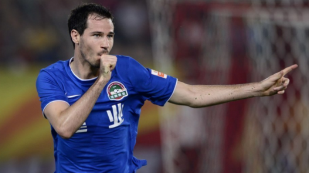Defender Ryan McGowan celebrates scoring in the Chinese Super League.