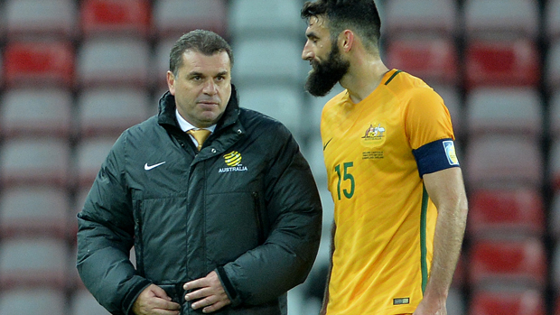 Ange Postecoglou with Mile Jedinak following the Socceroos' loss to England.