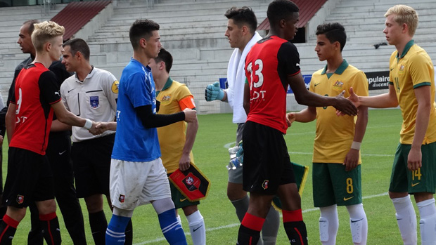 Joeys players shake hands with Stade Rennais players prior to kick off.