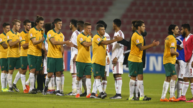 The Olyroos and UAE shake hands at full-time in Doha.