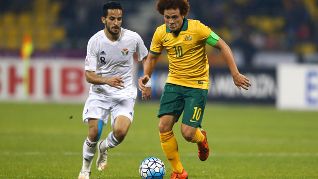 Olyroos skipper Mustafa Amini tries to break free from his Jordan marker.