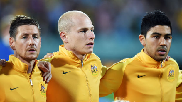 Caltex Socceroos Nathan Burns, Aaron Mooy and Massimo Luongo before kick-off against Tajikistan in Adelaide.