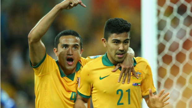 Tim Cahill and Massimo Luongo celebrate after combining to score for the Socceroos at the Asian Cup.