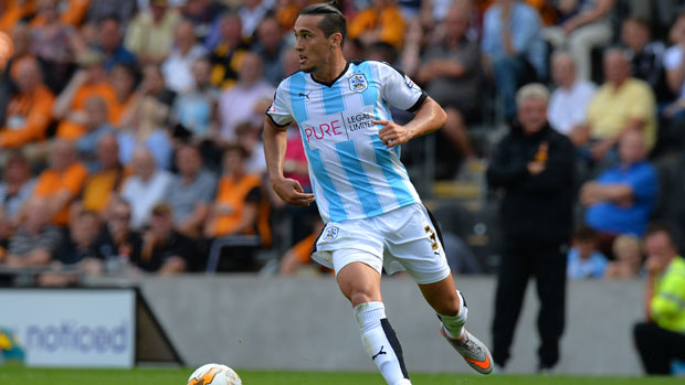Jason Davidson surges forward during his time at Huddersfield.