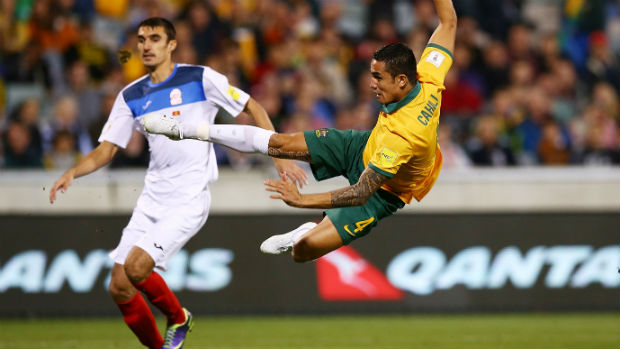 Socceroo Tim Cahill fires a shot against Kyrgyzstan in World Cup qualifying.
