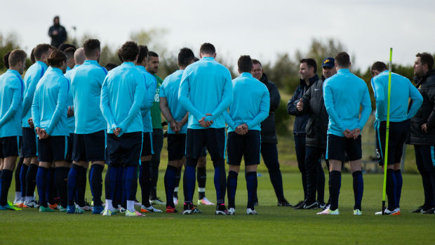 The Caltex Socceroos receives instructions from coach Ange Postecoglou at their training camp in Sunderland.