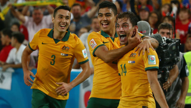 Adelaide-born Socceroos attacker James Troisi celebrates his winner in the Asian Cup final with Jason Davidson and Massimo Luongo.