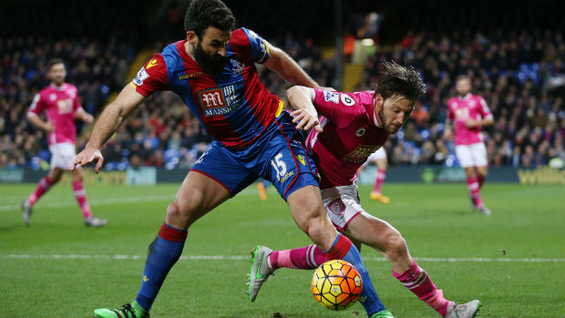 Crystal Palace captain Mile Jedinak jostles for the ball with Bournemouth's Harry Arter.