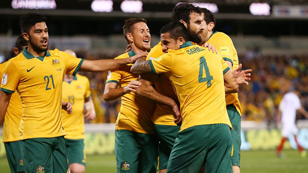 Socceroos players celebrate after Mile Jedinak opened the scoring from the penalty spot.