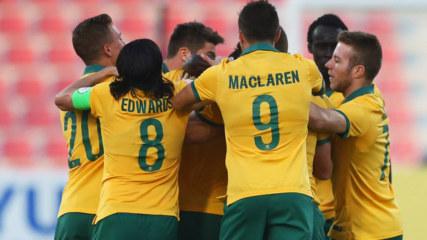Olyroos players celebrate James Donachie's early goal against Vietnam.