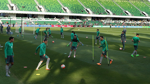 Socceroos players maintain possession during a training session in Perth.