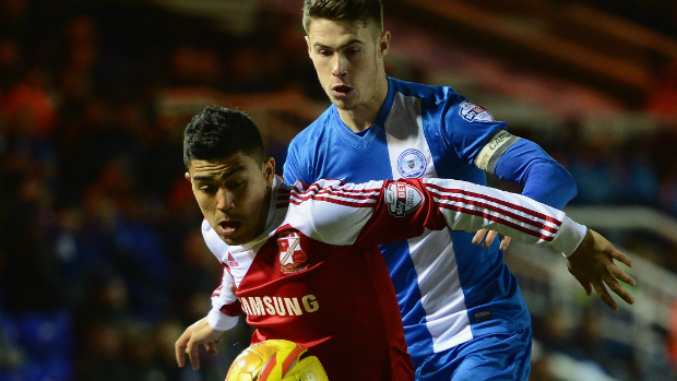 Socceroos midfielder Massimo Luongo on the ball for Swindon Town.