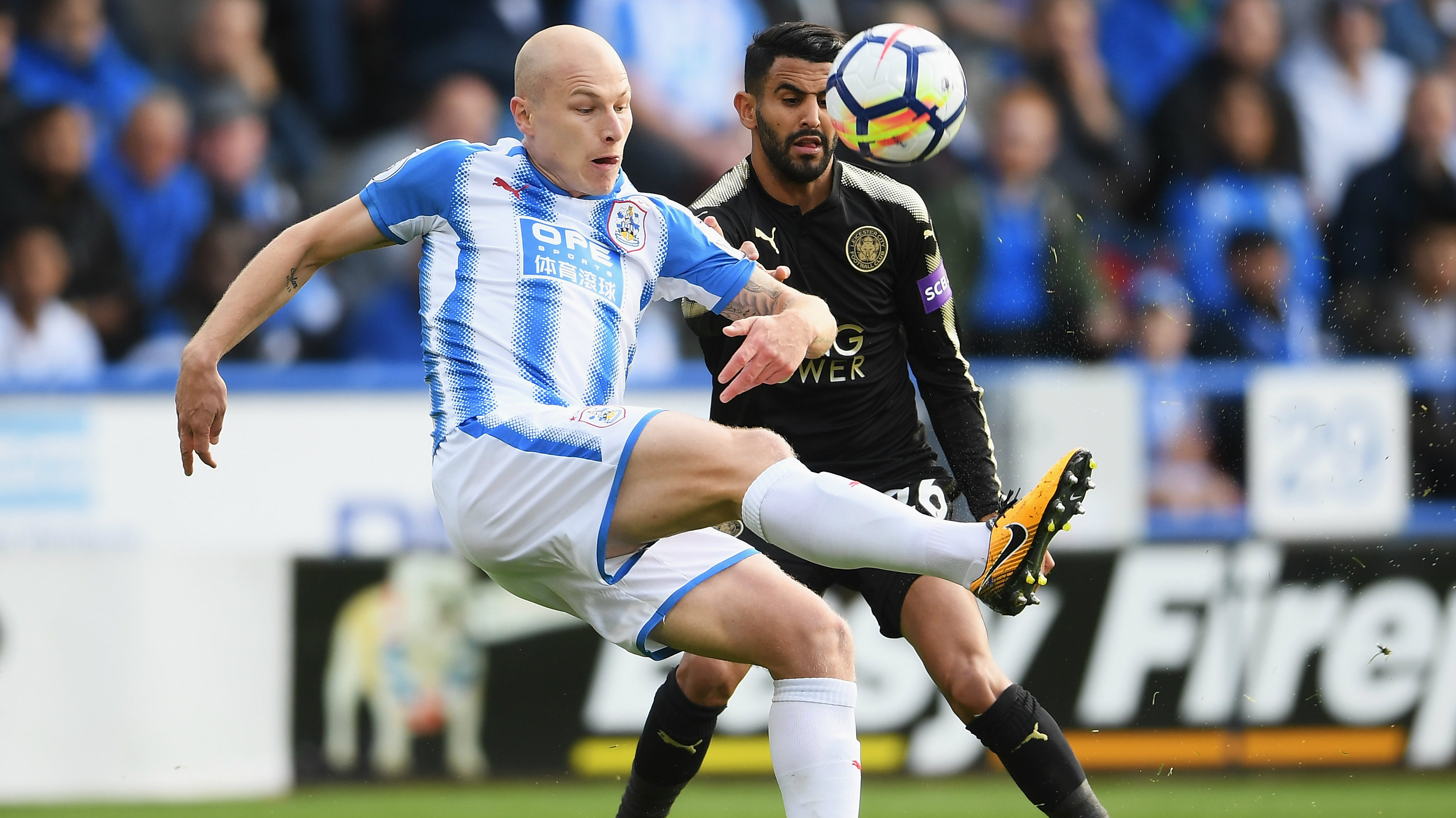 Aaron Mooy - pictured here under pressure from Riyadh Mahrez - was superb in Huddersfield's 1-1 draw with Leicester City.