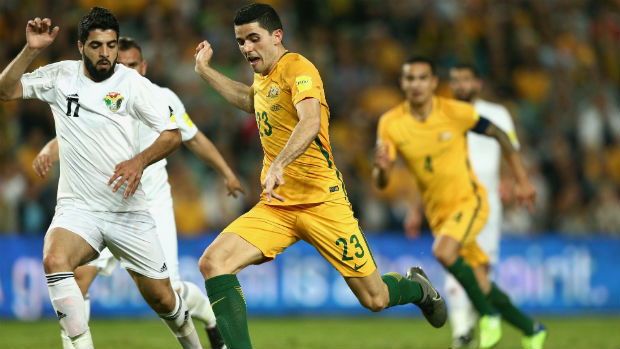 Tom Rogic unleashes a shot against Jordan at Allianz Stadium.
