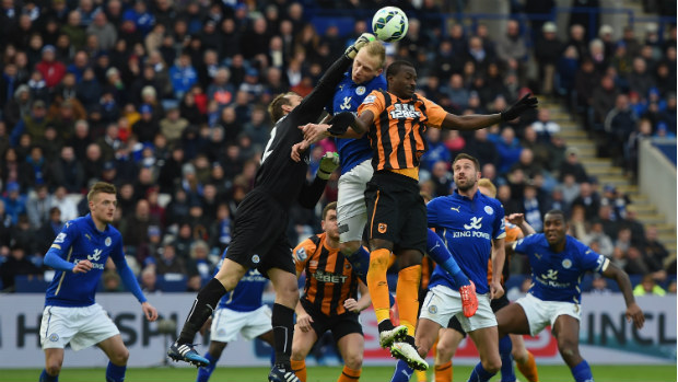 Mark Schwarzer flies high to get a fist to the ball for Leicester City.