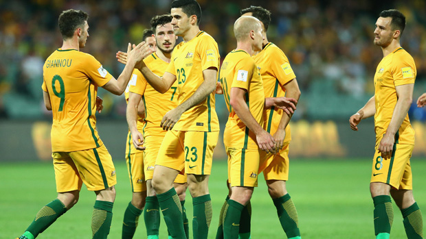 Caltex Socceroos players celebrate a Tom Rogic goal against Tajikistan.