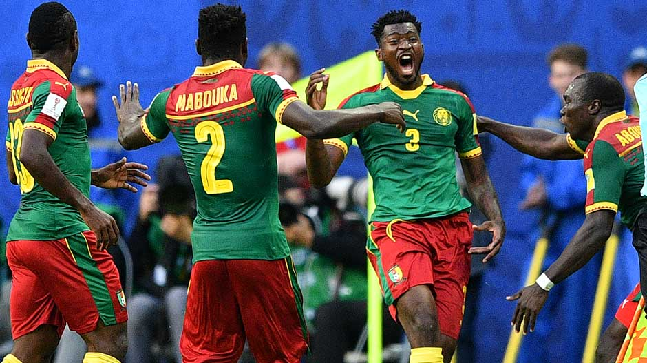 Cameroon players celebrate Andre Zambo Anguissa's goal right on the stroke of half-time to take a 1-0 lead to the break.