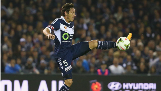 Victory skipper Mark Milligan brings the ball under control at Etihad Stadium.