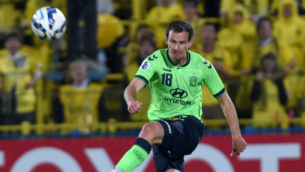Alex Wilkinson makes a clearance for Jeonbuk Motors in the AFC Champions League.