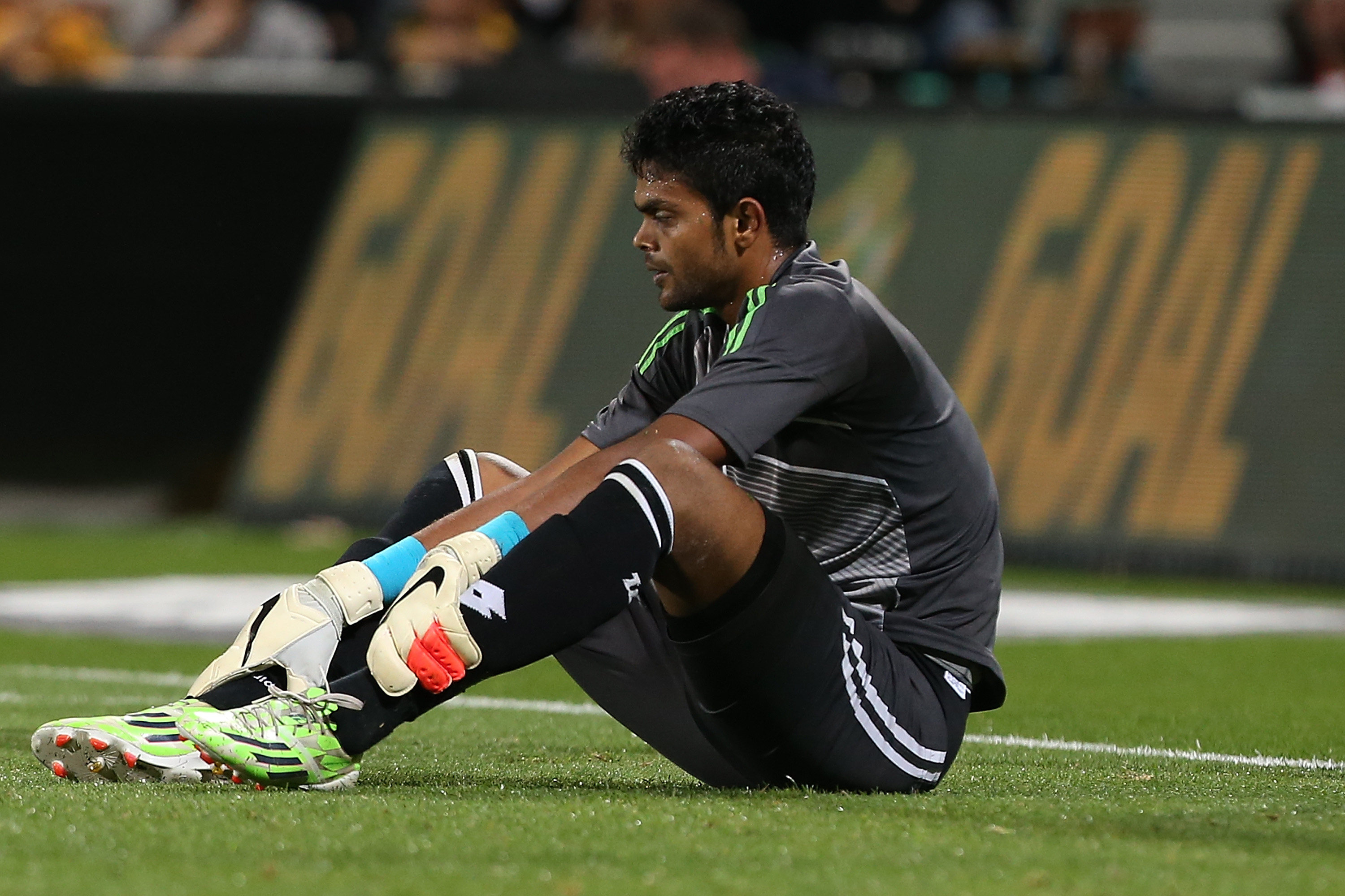 Bangladeshi keeper Alam Sahidul looks on after conceding a fourth goal inside the first half.