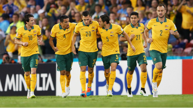 The Socceroos celebrate Trent Sainsbury scoring the opening goal in their Asian Cup semi-final.