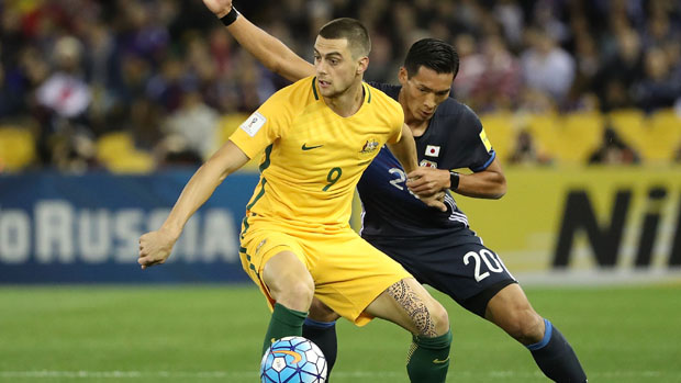 Tomi Juric fights off the attention of Japanese defender Tomoaki Makino.