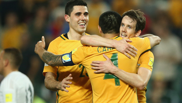 Socceroos Tim Cahill, Robbie Kruse and Tom Rogic celebrate a goal against Jordan.