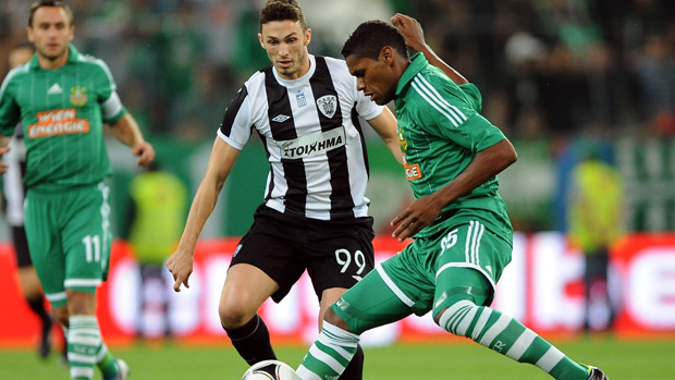 Paok Thessaloniki's Apostolos Giannou (L) vies for the ball with Rapid Vienna's Gerson (R) in the UEFA Europa League in 2012.