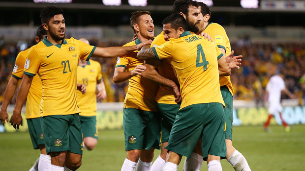 Socceroos players celebrate Mile Jedinak's opener against Kyrgyzstan in Canberra.