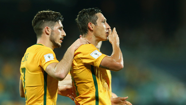 Mark Milligan celebrates a goal with teammate Mat Leckie.