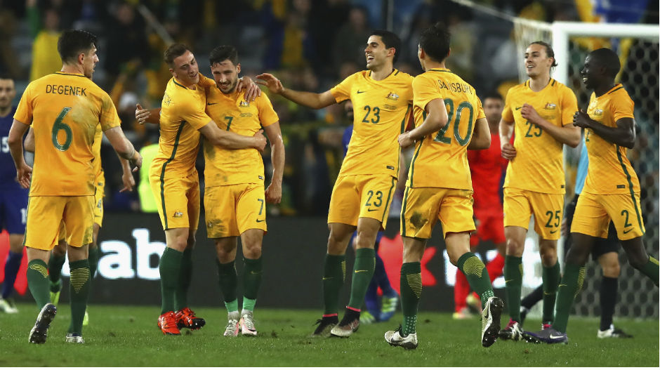 The Caltex Socceroos celebrate Mathew Leckie's late winner at ANZ Stadium.
