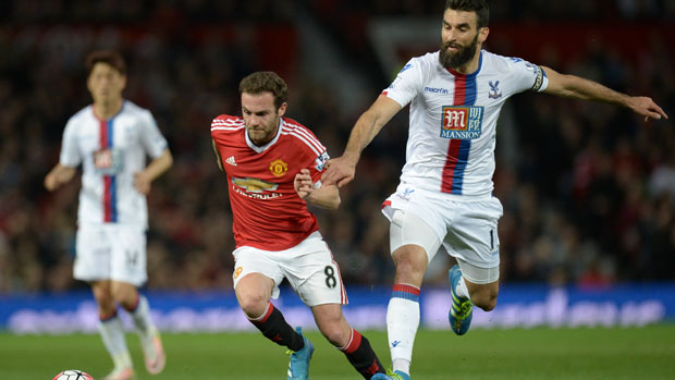 Mile Jedinak fights for the ball with Manchester United's Juan Mata.