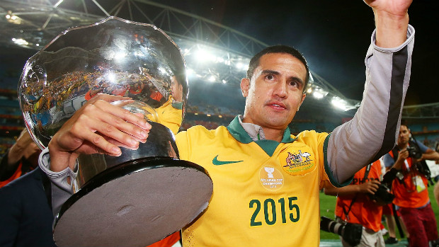 Socceroos striker Tim Cahill holds the Asian Cup aloft at Stadium Australia.